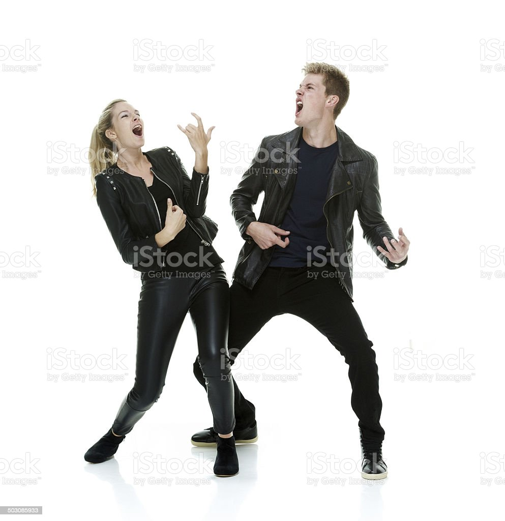 Two people playing air guitar stock photo
