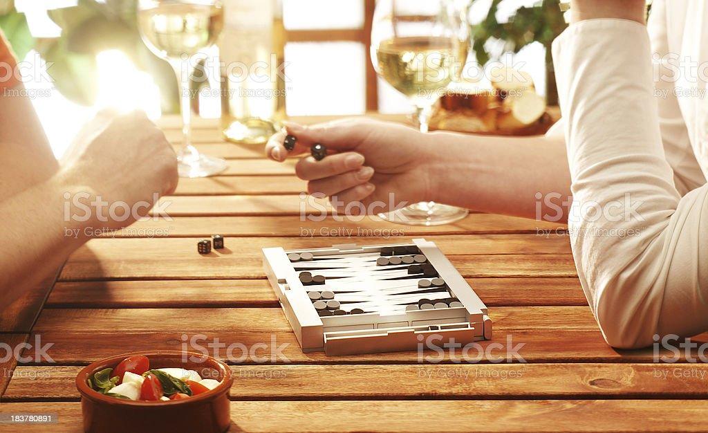 two people playing backgammon stock photo