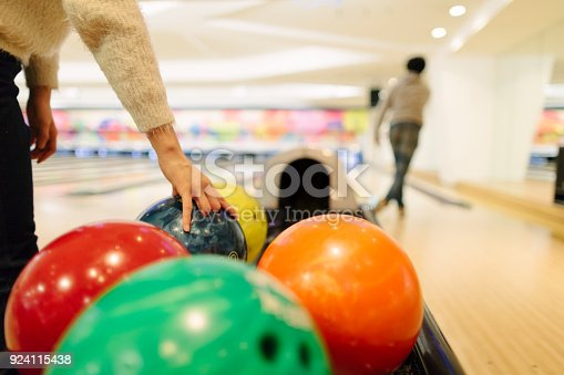 Two Japanese people are playing bowling.