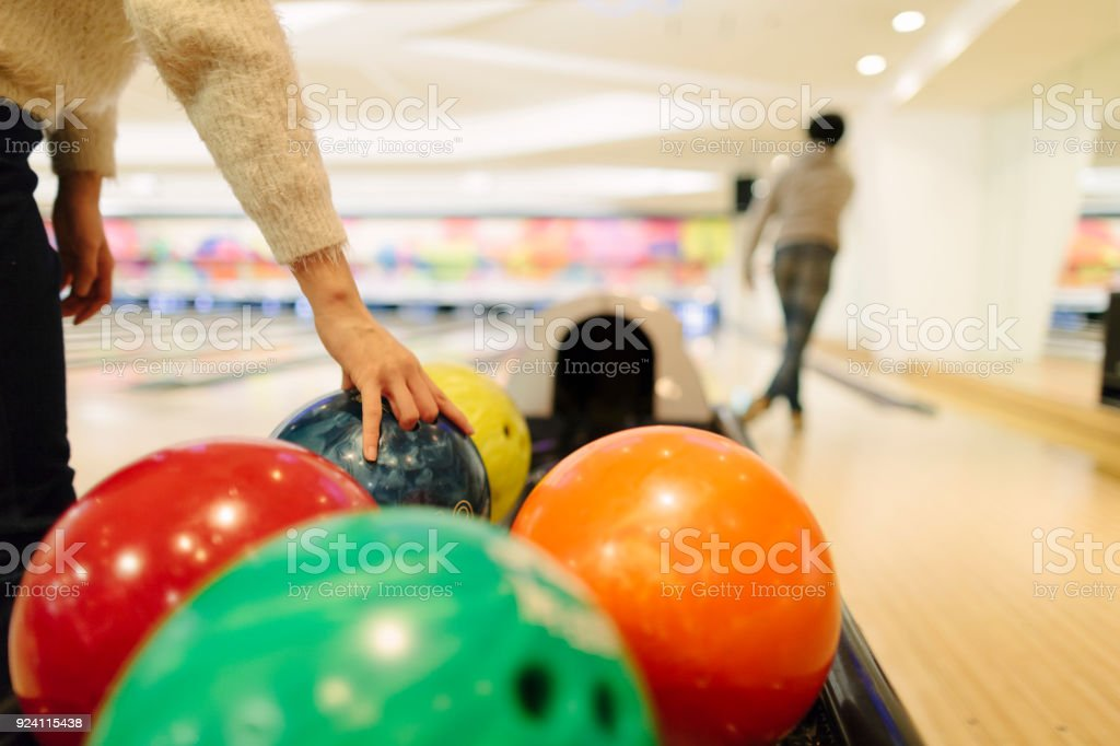 Two people playing bowling stock photo