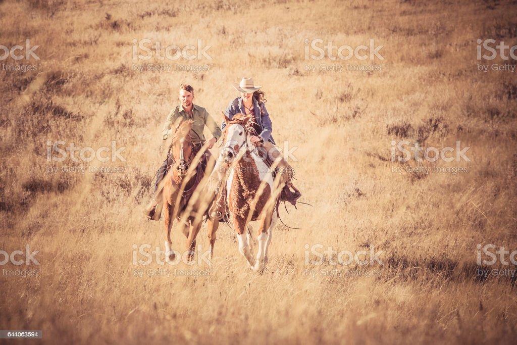 Two People Riding Horseback royalty-free stock photo
