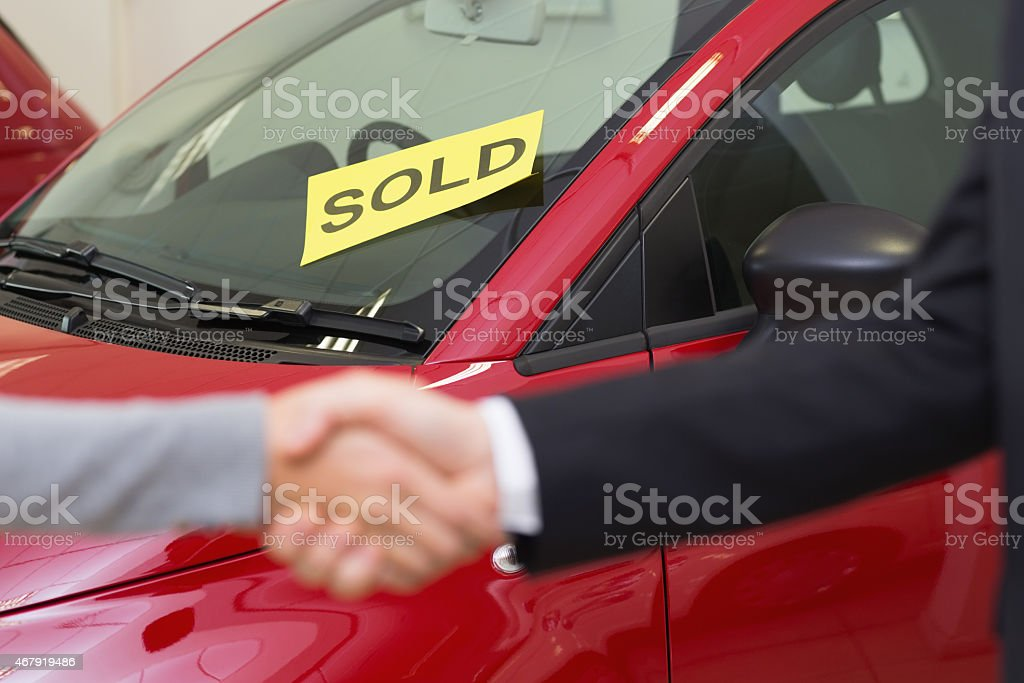 Two People Sealing A Car Sale With A Handshake Stock Photo & More ...