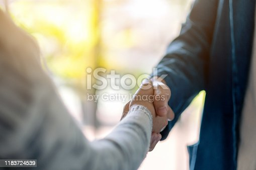 Closeup image of two people shaking hands