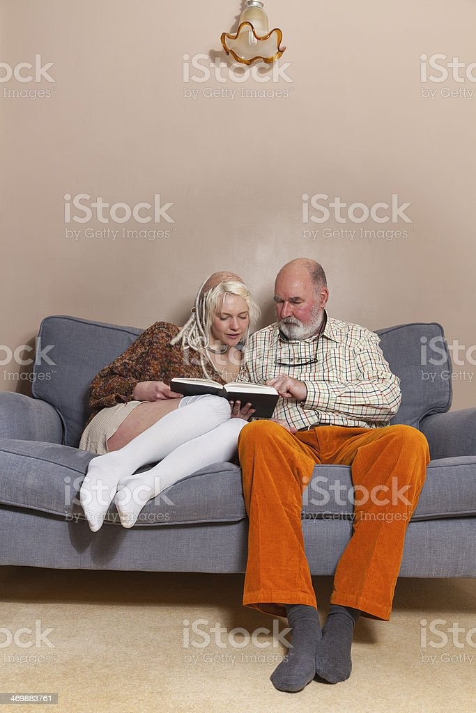 Two People Sharing A Book royalty-free stock photo