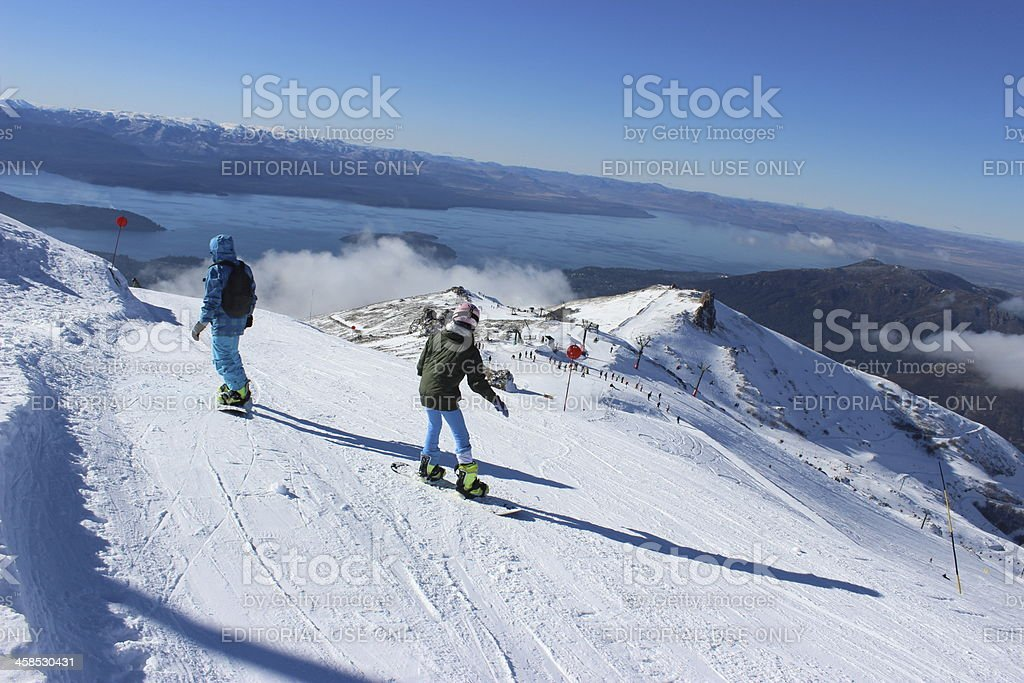 Two people skiing with Gutierrez lake at background - Patagonia stock photo