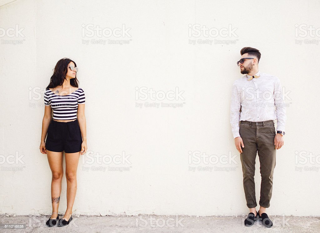 Two people standing on white wall background stock photo