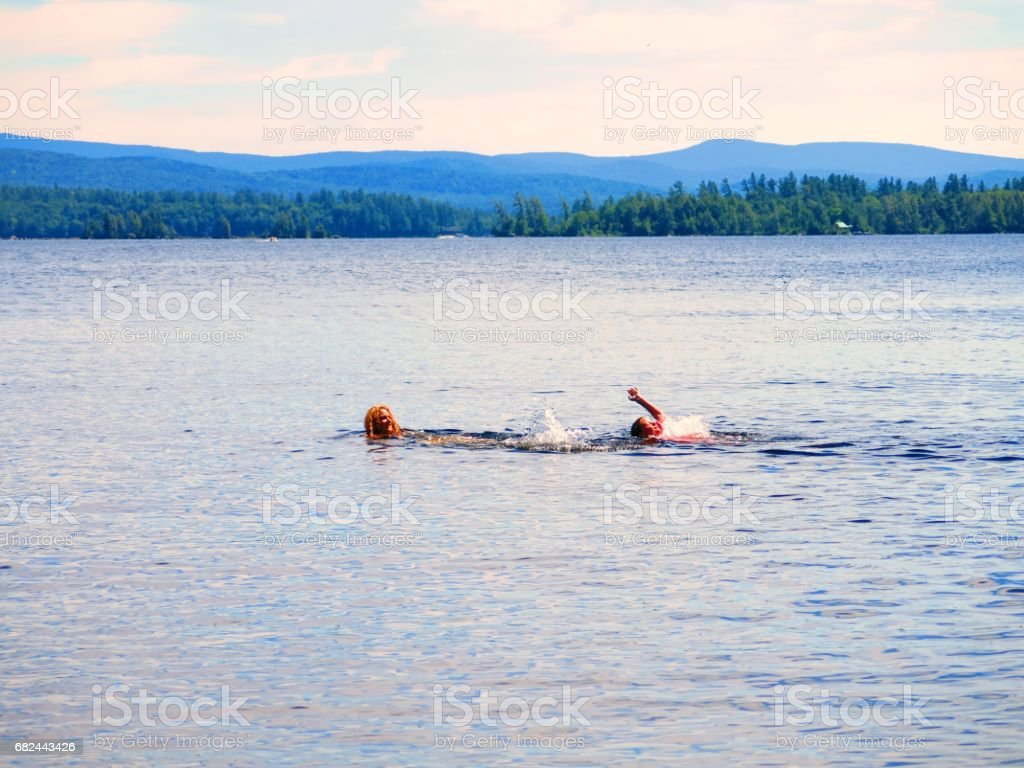Two People Swimming in Racquette Lake, Adirondacks, New York State 免版稅 stock photo