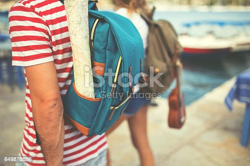 istock Two people traveling around Greek islands 649878886