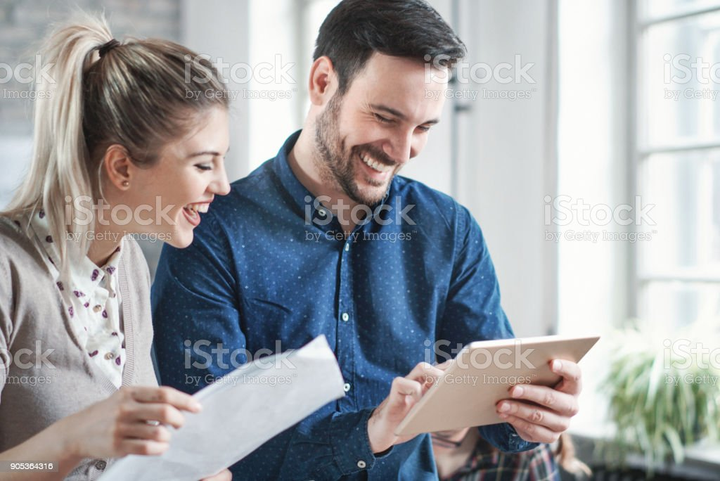 Closeup of mid 20\'s man and woman using a digital tablet during their...