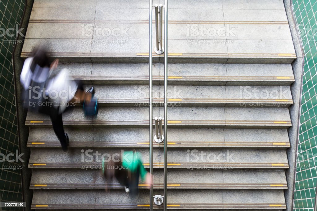 Two people viewed from above and blurred by movement. stock photo