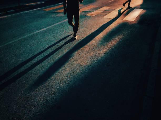 Two people walking on urban road