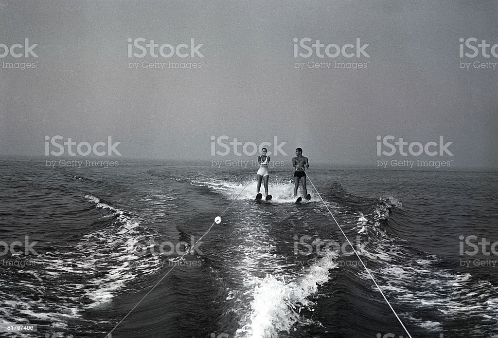 Two people waterskiing stock photo