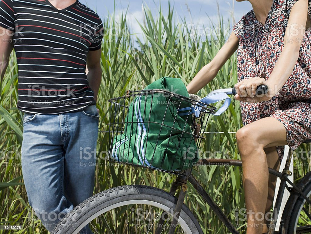 Two people with bike 免版稅 stock photo