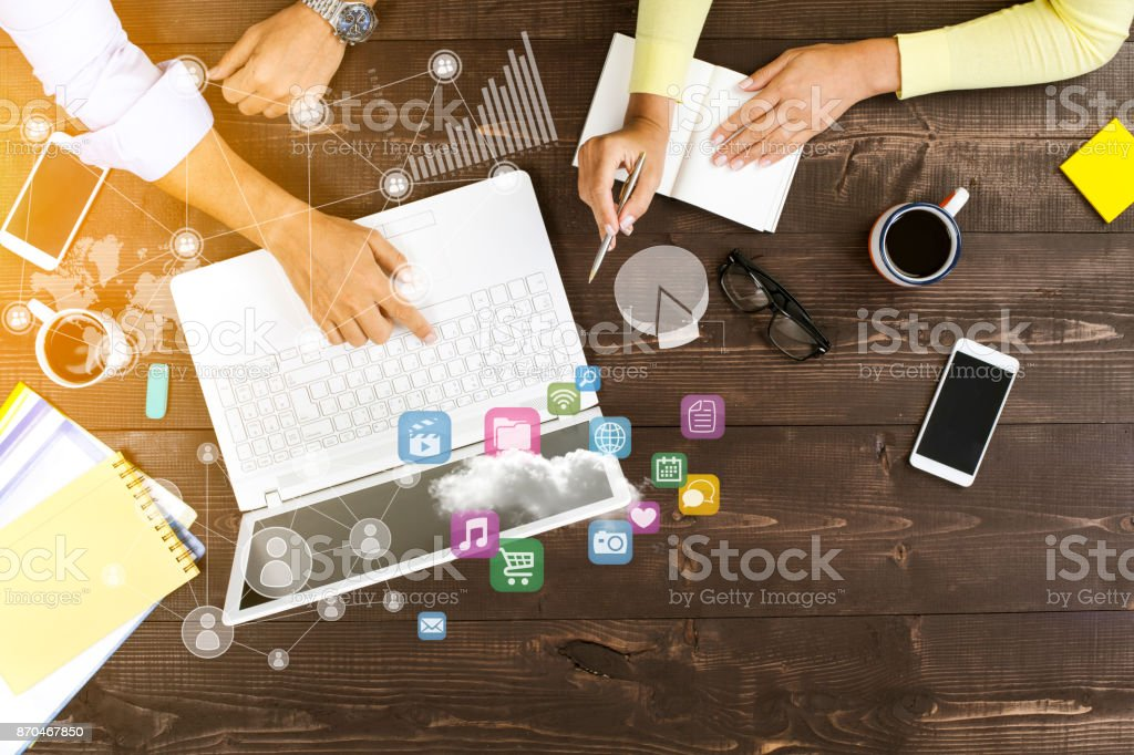Two people working on computer stock photo