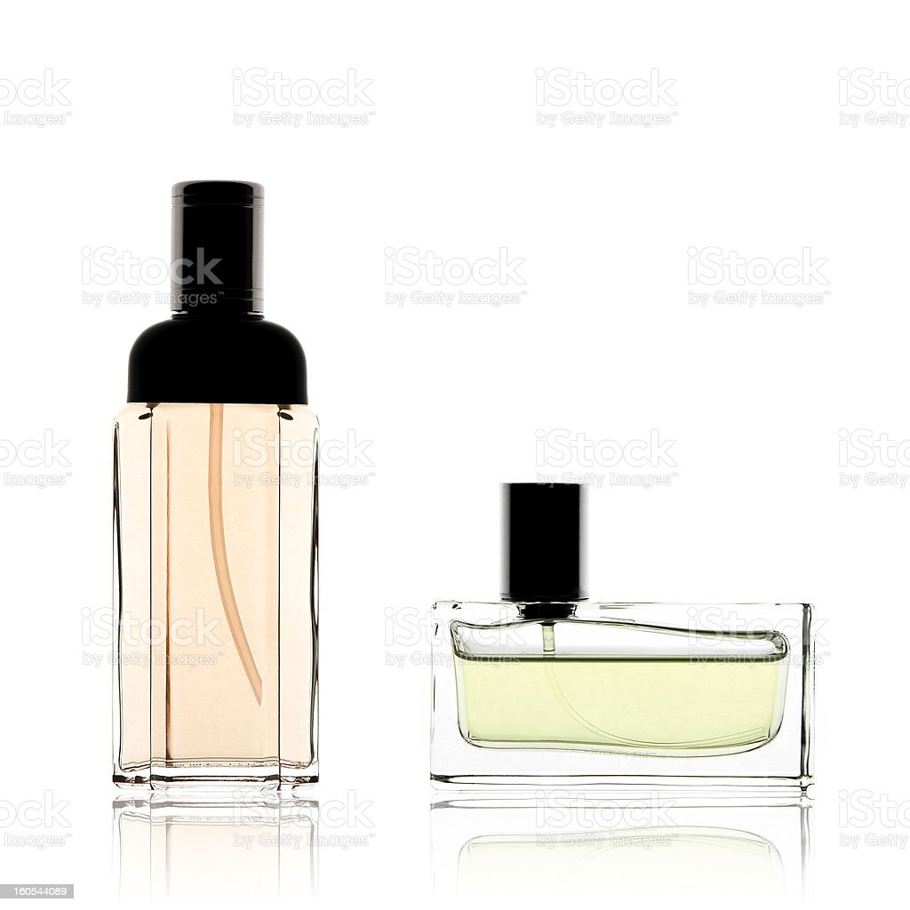 Two perfume bottles vertical and horizontal, isolated on white stock photo