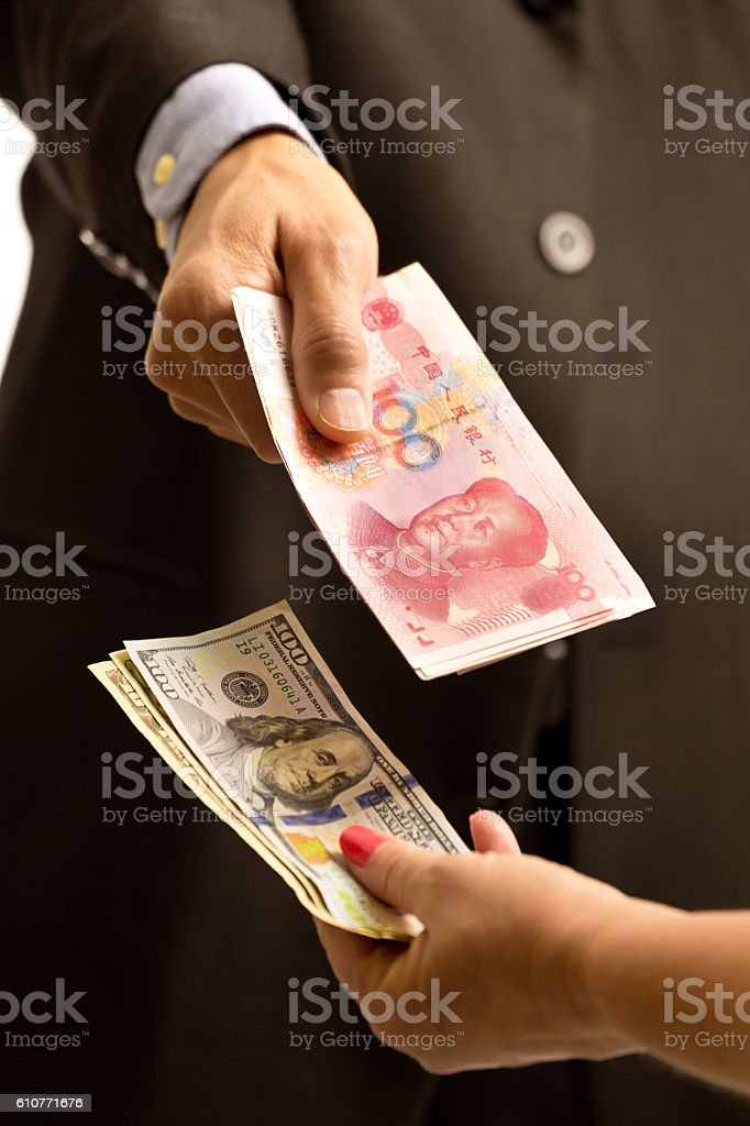Two Persons Exchanging Foreign International Currency Euros and Dollars stock photo
