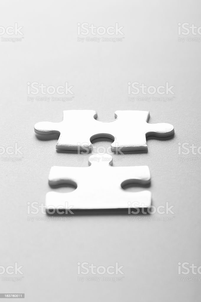 Two Pieces of a Jigsaw Puzzle royalty-free stock photo