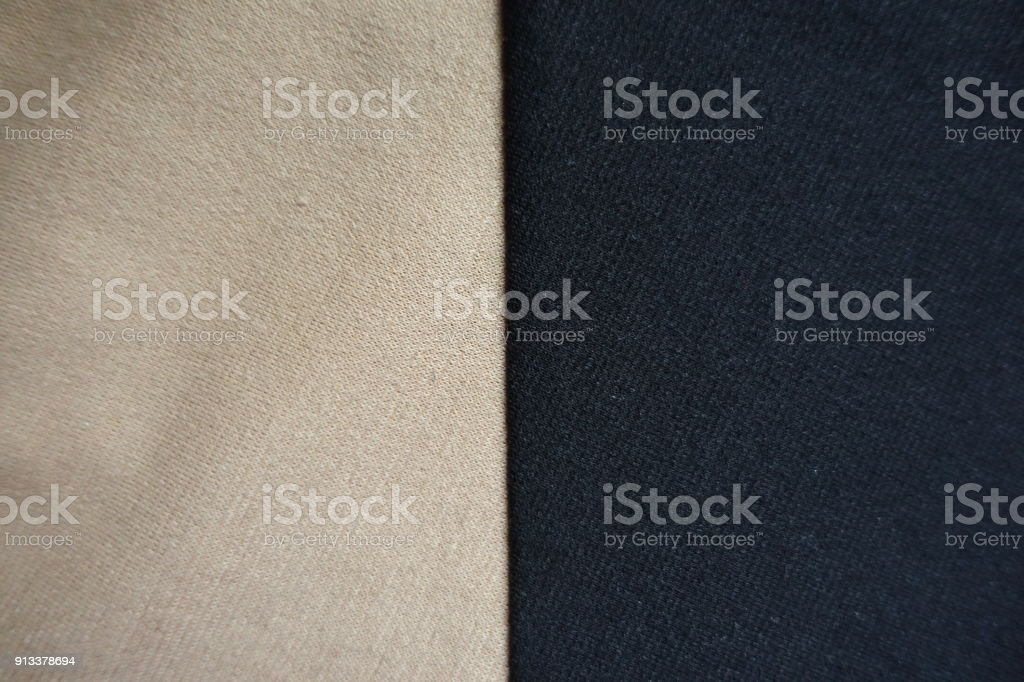 Two pieces of beige and black fabric sewn together stock photo