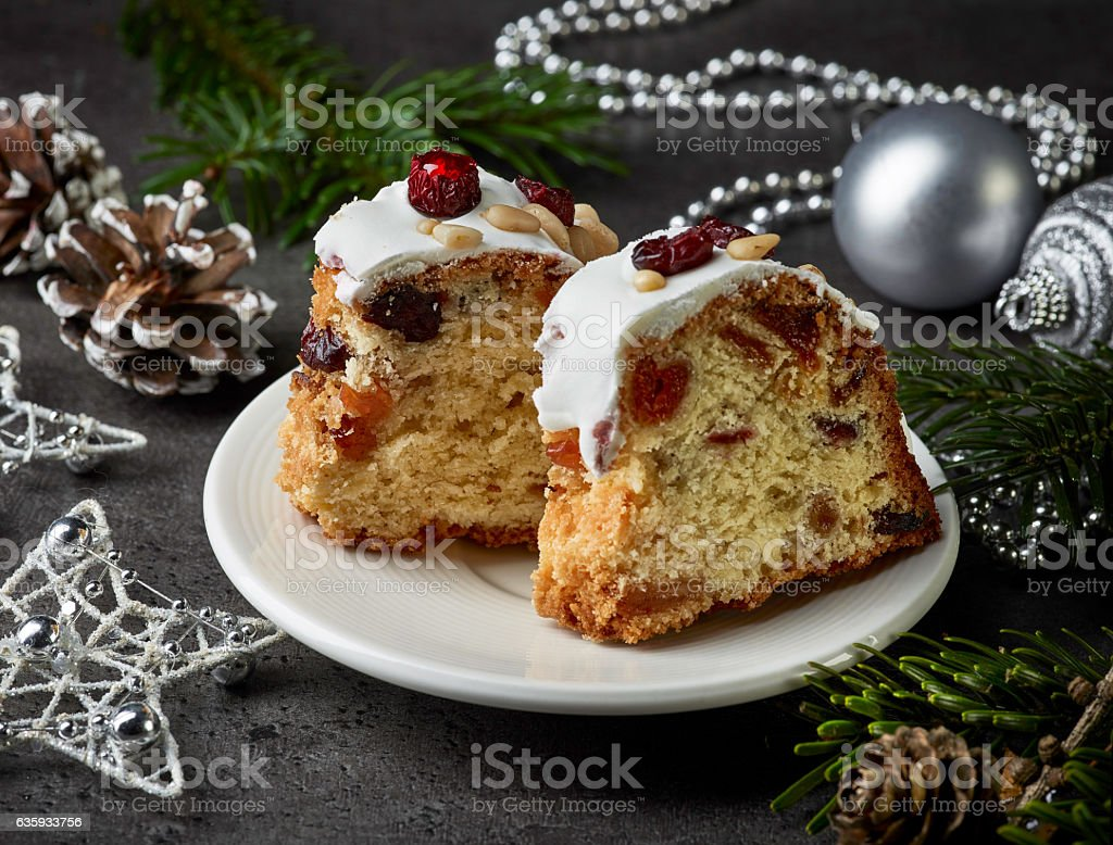 two pieces of christmas cake with fruits and nuts stock photo