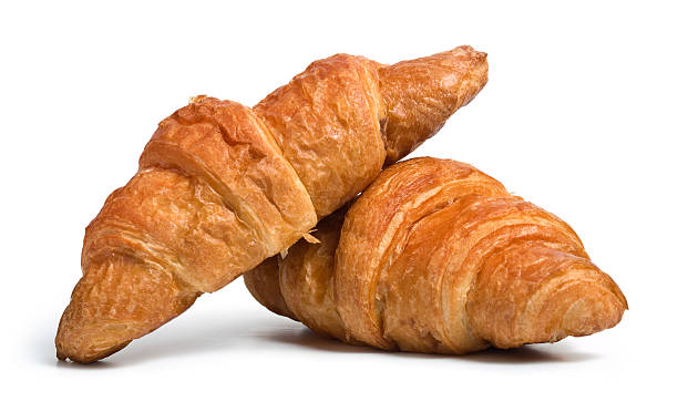 Two pieces of croissant bread  Fresh croissants on white.  croissant stock pictures, royalty-free photos & images