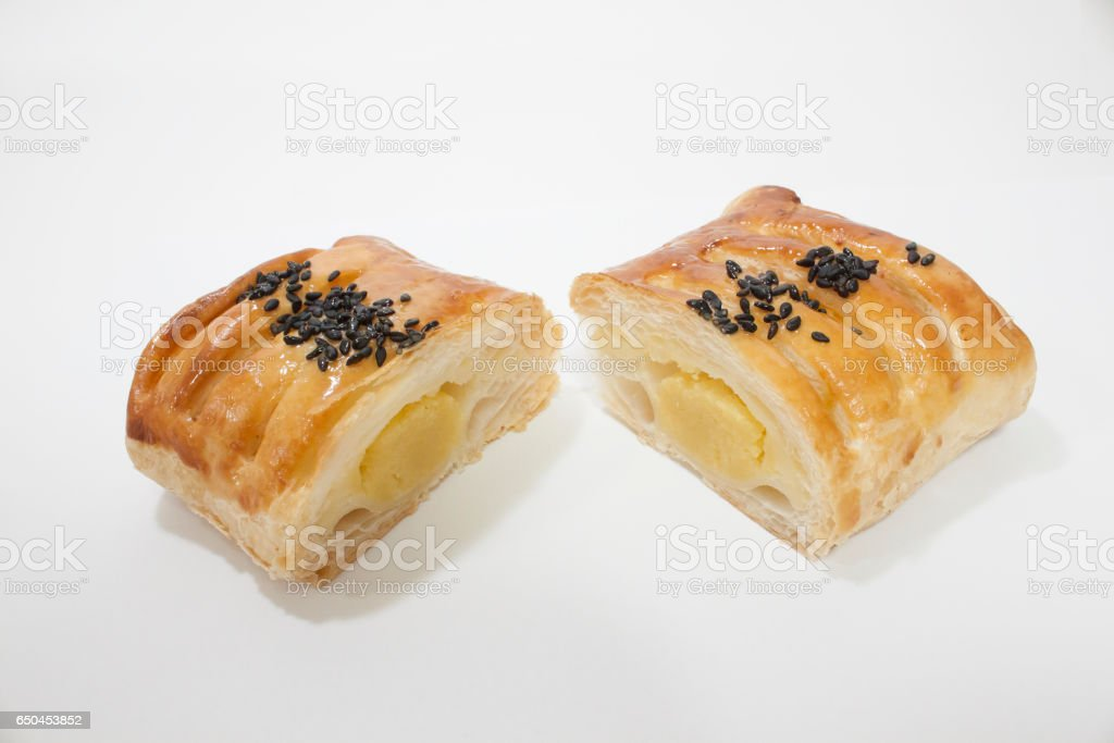 Two pieces of cut in half pastry bread stock photo
