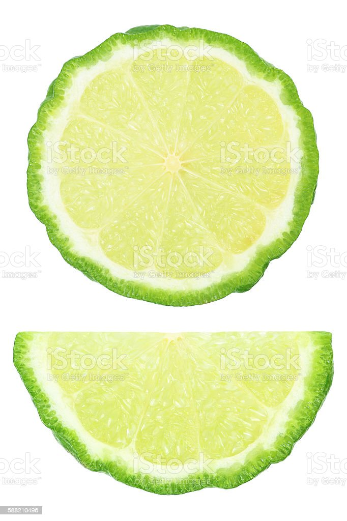 two pieces of sliced kaffir lime isolated on white stock photo