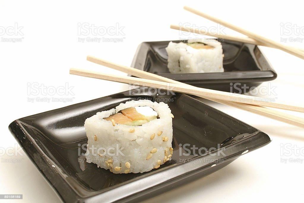Two pieces of smoked salmon sushi on white royalty-free stock photo