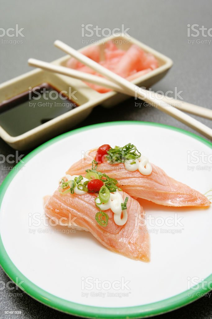 Two Pieces of Sushi with Chopsticks and Ginger royalty-free stock photo
