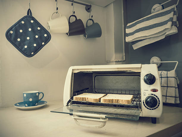 Two pieces of toasts in the oven.(Vintage tone color) stock photo