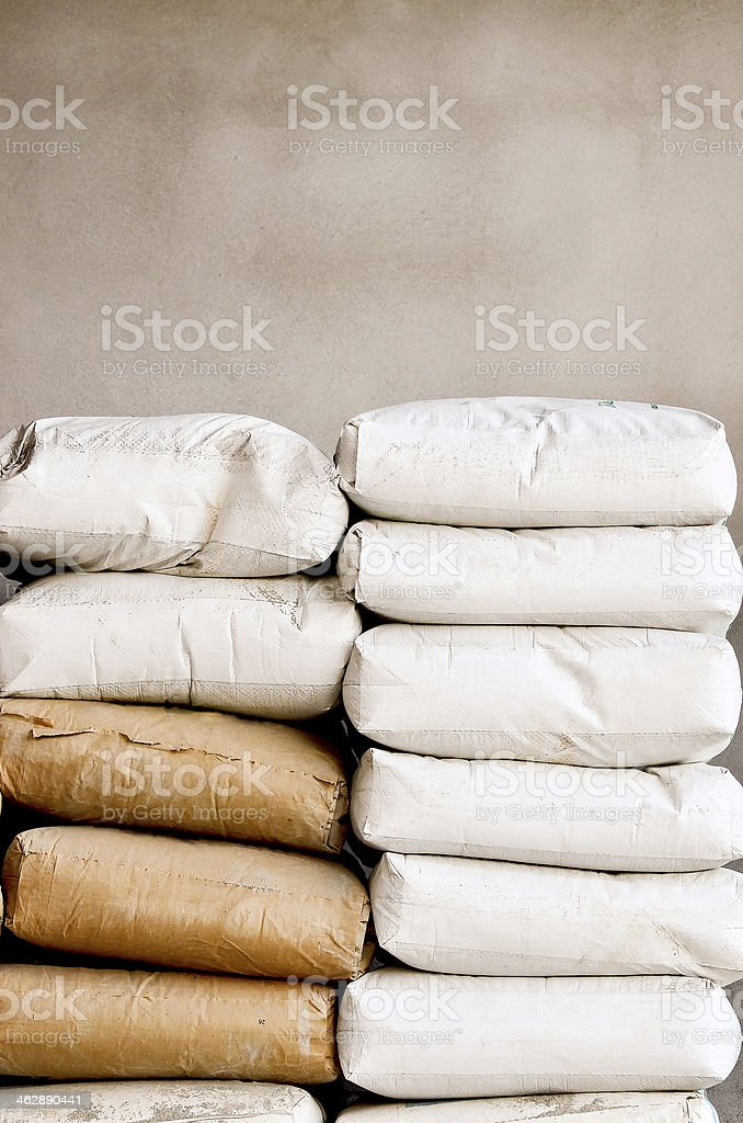 Two piles of cement bags in two different colors stock photo