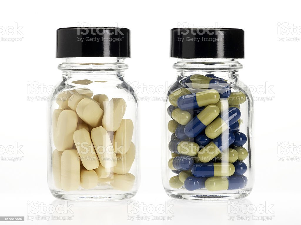 Two pills bottles stock photo