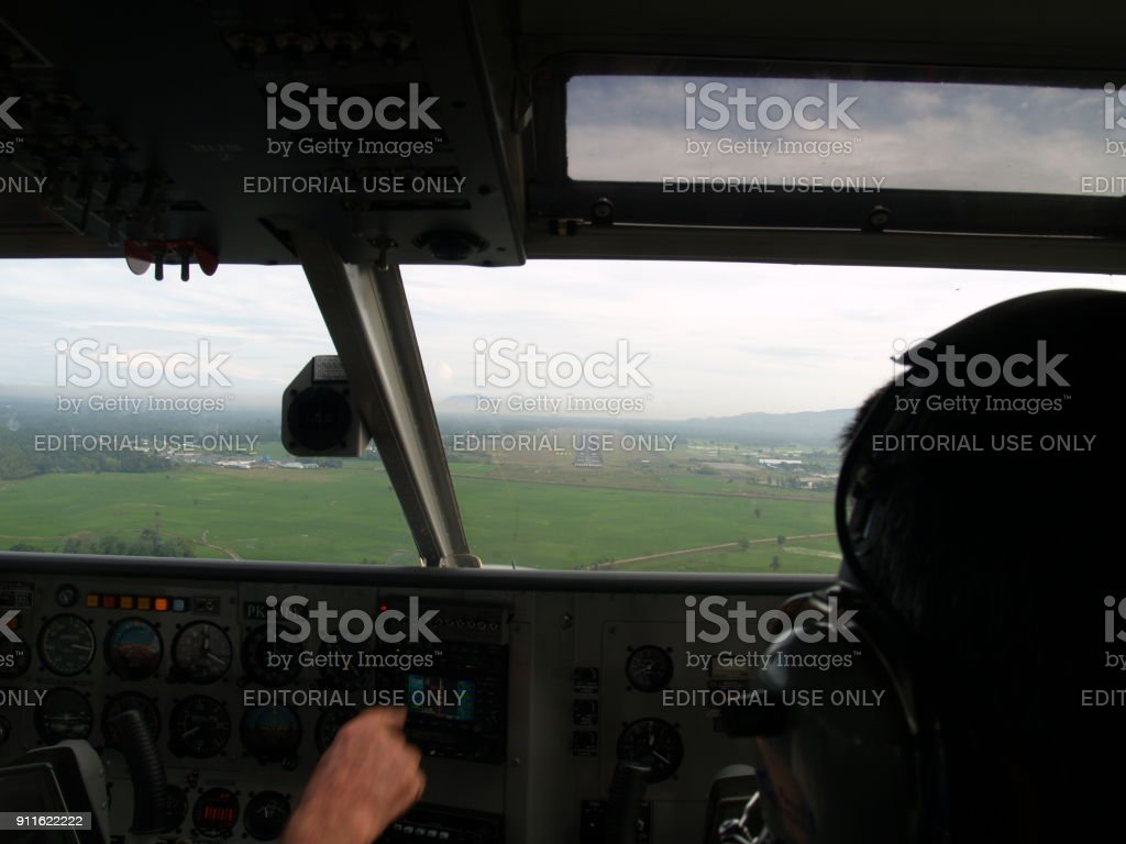 Two Pilots in Cockpit Prepare for landing stock photo
