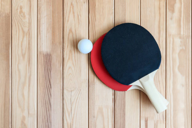 two ping pong paddles with ball - table tennis racket stock pictures, royalty-free photos & images