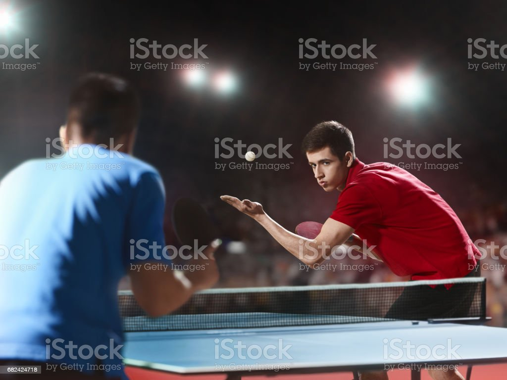 Two ping pong players play table tennis royalty-free stock photo