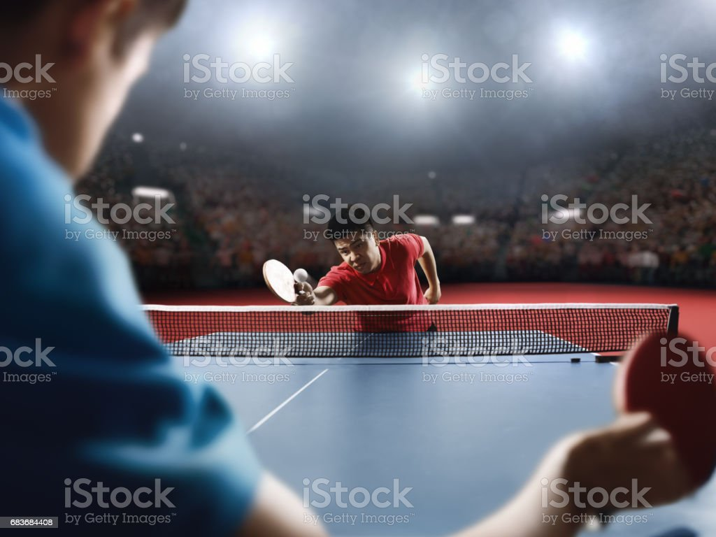 Two ping pong players play table tennis stock photo