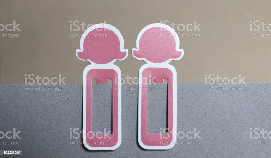 Two pink female-shaped bookmarks. stock photo