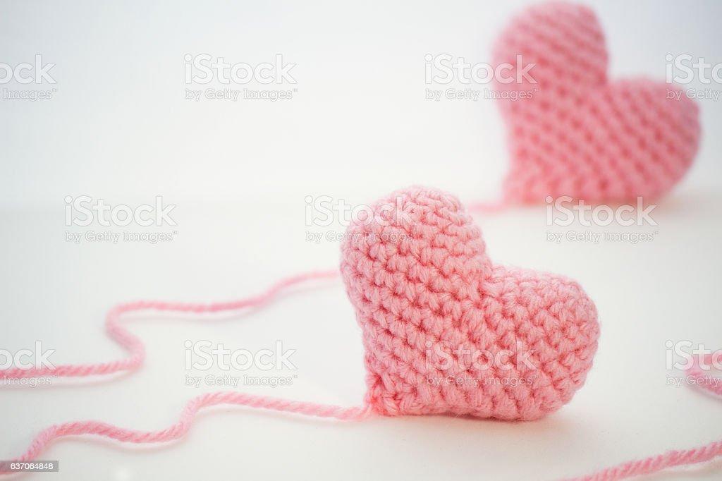 Two pink handmade crochet hearts - foto de stock