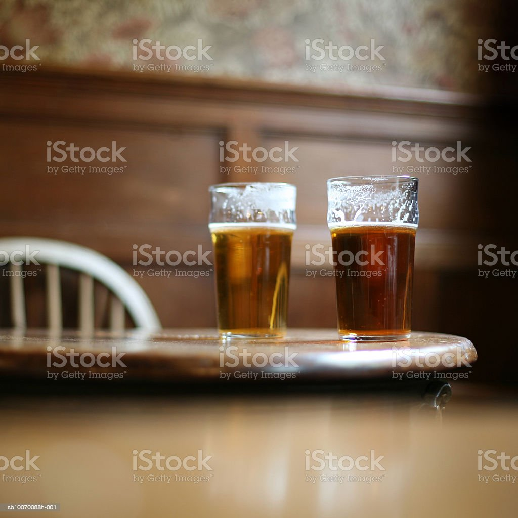 Two pints of beer on table royalty-free stock photo