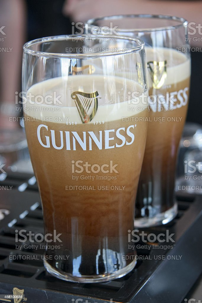 Two pints of beer served at The Guinness Brewery stock photo