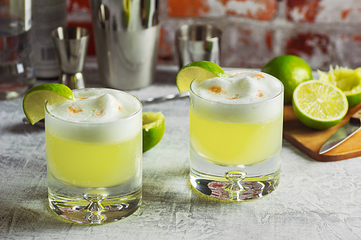 Two Pisco Sour Cocktails On The Bar With Ingredients Stock Photo - Download Image Now