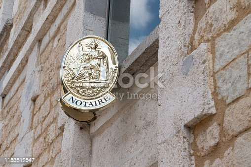 845085240istockphoto two plate notary in building office for french Notaire 1153512547