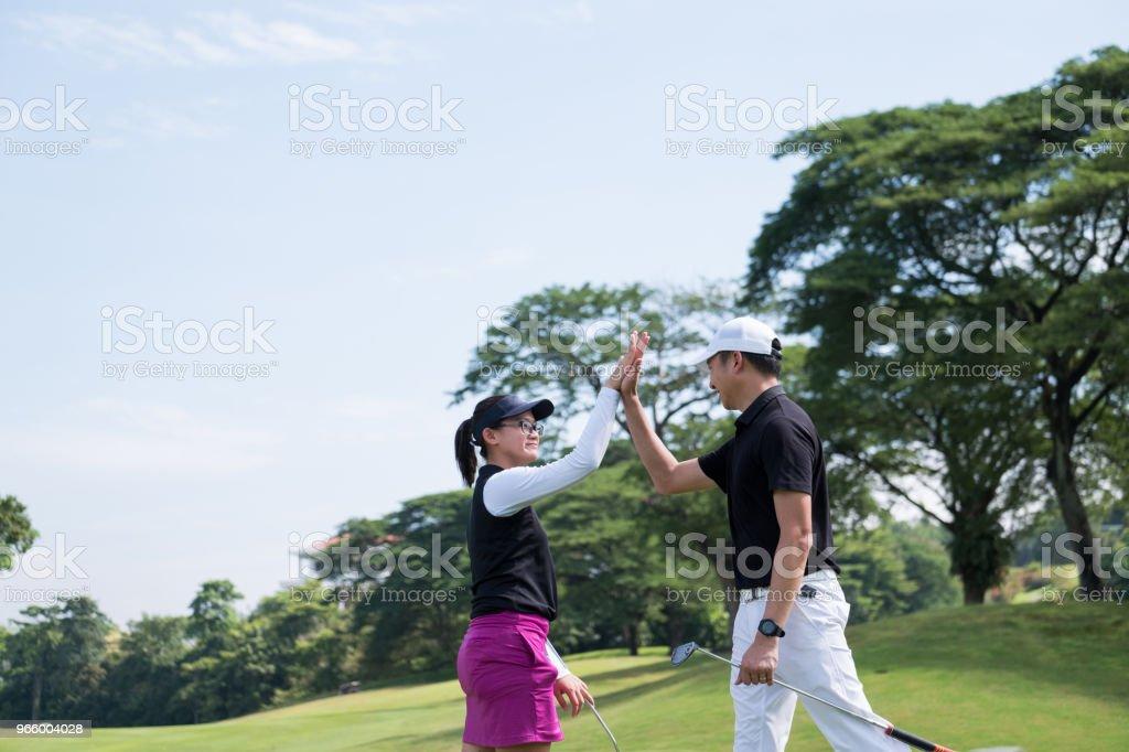 Hoge 5 na dat spel van golf - Royalty-free 20-29 jaar Stockfoto