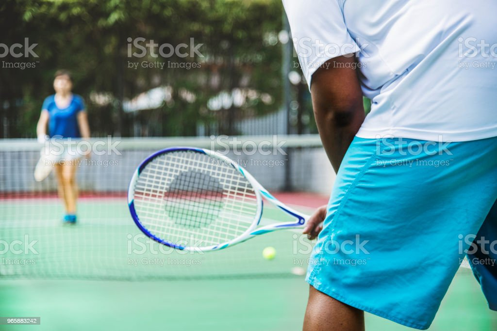 Two players in a tennis match Two players in a tennis match African Ethnicity Stock Photo