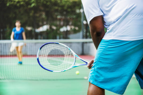 two players in a tennis match - tennis stock pictures, royalty-free photos & images