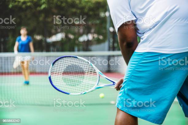 Two Players In A Tennis Match Stock Photo - Download Image Now