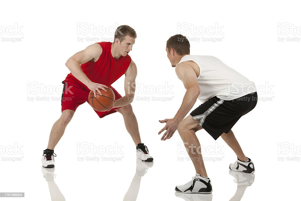 Two players playing basketball royalty-free stock photo