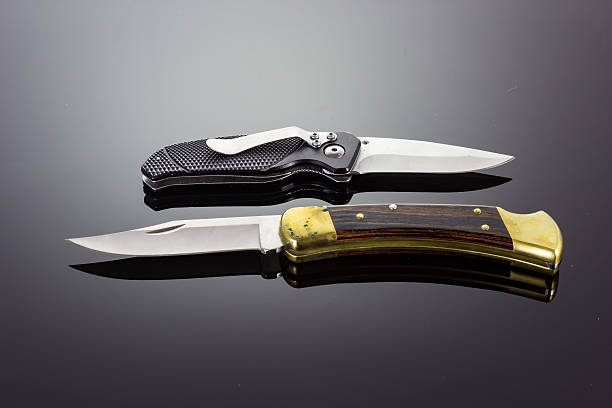 Two pocket knifes Taken on February 23, 2016 - Two pocket knives switchblade stock pictures, royalty-free photos & images