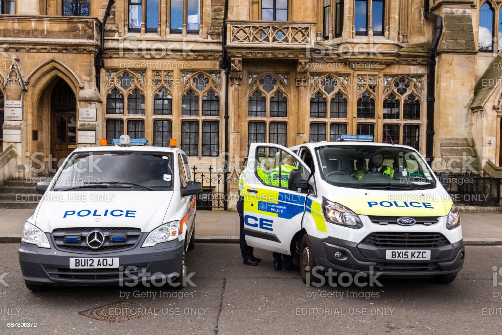 Two police car outside of St Margaret's Church in standby, London, Uk. stock photo