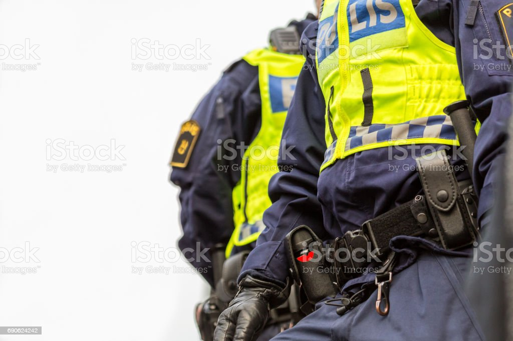 Two police officers, close up of upper body with vest and equipment belt. stock photo