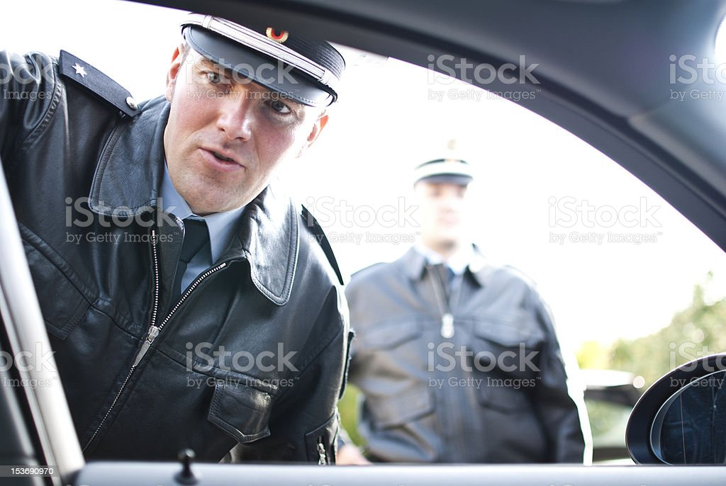 two police officers doing a traffic control stock photo